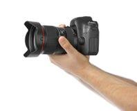 Photo camera in hand Royalty Free Stock Photo