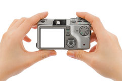 Photo camera in hands stock photography