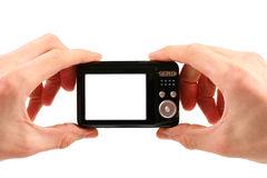 Photo camera in hands Stock Images