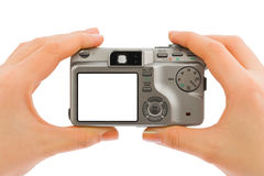 Photo camera in hands Royalty Free Stock Photos