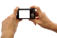 Photo camera in hands isolated on white background. Hands of a man holding a digital camera on a white background stock image