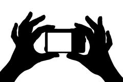 Photo camera in hands Royalty Free Stock Images