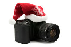 Photo camera with hat of Santa Stock Photo