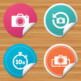 Photo camera icon. Flip turn or refresh signs. Round stickers or website banners. Photo camera icon. Flip turn or refresh symbols. Stopwatch timer 10 seconds Stock Photos