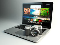 Photo camera and laptop with image viewer on the screen. Digital Stock Image
