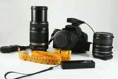 Photo camera, lens. Remote and measuring tape, set for the photographer Royalty Free Stock Image