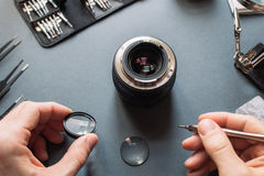 Photo camera lens repair set. Engineer maintenance stock photo