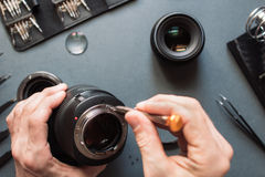 Photo camera lens repair set. Engineer maintenance royalty free stock images