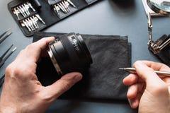 Photo camera lens repair set. Maintenance support Stock Image