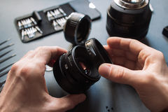 Photo camera lens repair set. Technician engineer royalty free stock photo