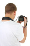Photo camera in male hands Stock Photography