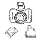 Photo camera, memory card and film roll sketches. Photo camera with memory card and film roll sketch icons, isolated on white Royalty Free Stock Photos