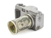 Photo camera and money stock photos
