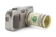 Photo camera and money stock photography