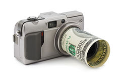 Photo camera and money Royalty Free Stock Photos