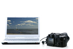Photo camera and notebook Royalty Free Stock Photography