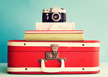 Photo camera over books Stock Images