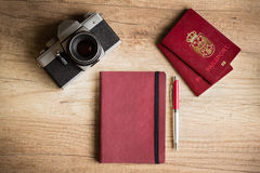 Photo camera and passport Stock Photos