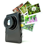 Photo camera with photos. On white Royalty Free Stock Photography