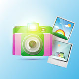 Photo camera with pictures Royalty Free Stock Photos