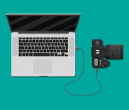 Photo camera plugged to laptop usb port. Import photos from camera to computer. Vector illustration in flat style Stock Photos