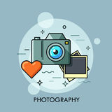 Photo camera, printed photos and heart. Photography lovers, favorite hobby concept. Photo camera, printed photos and heart. Photography lovers and favorite hobby Royalty Free Stock Images