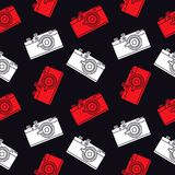 Photo camera seamless pattern. Seamless pattern with a retro film camera on a black background. Decor for textiles, wrapping paper, scrapbooking. Flat vector Royalty Free Stock Photo