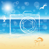 Photo camera silhouette on the sunny beach backgro Royalty Free Stock Photos