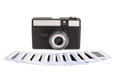 Photo camera with spun film and diapositive slides Royalty Free Stock Photography