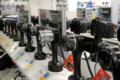 Photo camera store. Photo digital camera store displaying sony mirrorless and dslr stock image