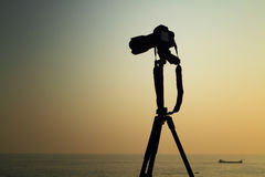 Photo camera on tripod outdoor. Camera  on tripod outdoor with clear sky background Royalty Free Stock Image