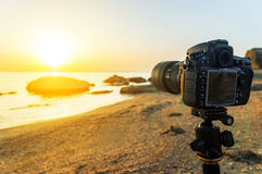 Photo camera on a tripod Stock Photos