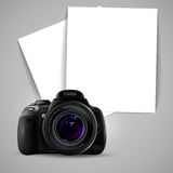 Photo camera and two sheets of paper Stock Photos