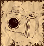 Photo camera  on vintage background Royalty Free Stock Images