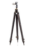 Photo camera on wooden tripod. Royalty Free Stock Photos