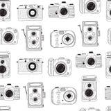 Photo cameras pattern. Hand drawn illustration. Royalty Free Stock Photo