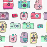 Photo cameras seamless pattern. Hand drawn doodle style photo camera seamless pattern. Cute  camera for poster, postcard, textile, wrapping paper design. Hand Royalty Free Stock Photos