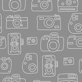 Photo cameras seamless pattern. Hand drawn doodle style photo camera seamless pattern. Cute  camera for poster, postcard, textile, wrapping paper design. Hand Stock Photos