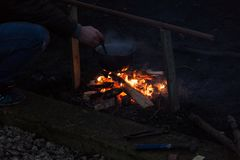 Photo of campfire. A late night roaring open air campfire and pot with mulled wine Stock Photos