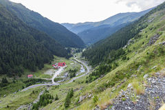 Photo of capra peak and famous winding road in fagaras mountains at sunset Royalty Free Stock Photos