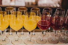 Colorful Cocktails in Bar. Photo captured in local fresh food restaurant. Brunch time with full table of fresh salads, beverages, snacks and drinks.. Colorful royalty free stock photography