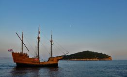 Caravel in the moonlight. Photo of a caravel leaving Dubrovnik at dusk - Croatia - July 2010 Royalty Free Stock Images