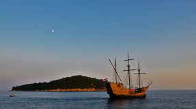 The caravel and the island at dusk. Photo of a caravel leaving Dubrovnik at dusk - Croatia - July 2010 Royalty Free Stock Photos