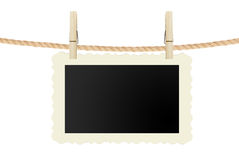 Photo card hanging on rope isolated on white Royalty Free Stock Photos