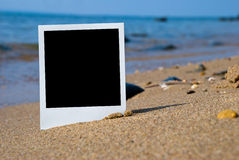 Photo card on sand beach Stock Photo