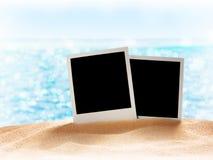 Photo card on sand beach. Stock Photos