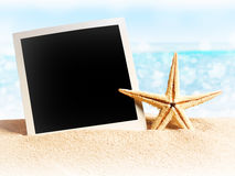 Photo card on sand beach. Stock Photo