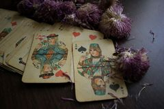 Photo of tarot card. Photo cards for fortune telling or playing. Old cards on a wooden background with flowers Royalty Free Stock Photo