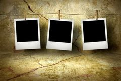 Photo cards on the grunge wall. Photo cards on the old grunge wall royalty free stock photos