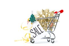 Photo of cart with golden snowflakes, Christmas tree, postcard, ribbon Stock Image
